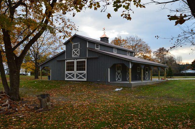 dark green modular barn exterior